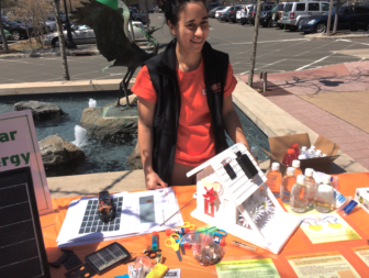 Nicole Sanchez of Direct Energy Solar. That model house in front of her is running a small fan from a solar cell.