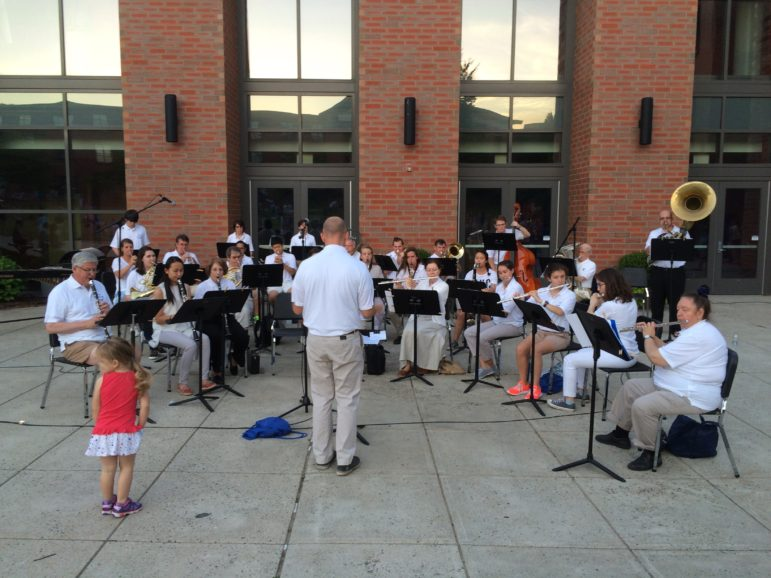 Darien Community Band gets a second conductor (in the red shirt).