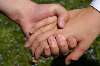 Two children holding hands, ages 10 and 8 by Elizabeth Ann Colette Flickr 03-29-17 Wikimedia Commons https://commons.wikimedia.org/wiki/File:Hold_my_hand.jpg