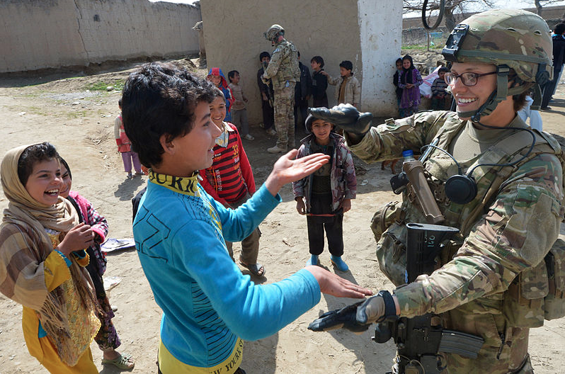 Soldier with Afghan School Children 2013 06-01-17