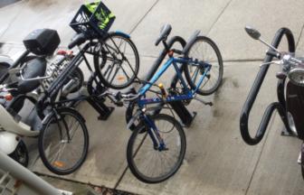 Bicycles parked Darien Railroad Station Darien Train Station Bikes 09-18-17