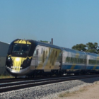 Cropped brightline BBT609 on Flickr via Wcommons https://commons.wikimedia.org/wiki/File:BrightLine_Inaugural_Run.jpg