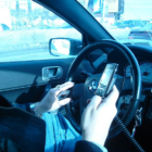 Distracted Driver Texting by Ed Poor of English Wikipedia on Wikimedia Commons 2007 https://commons.wikimedia.org/wiki/File:Hand_held_phone_in_car.JPG