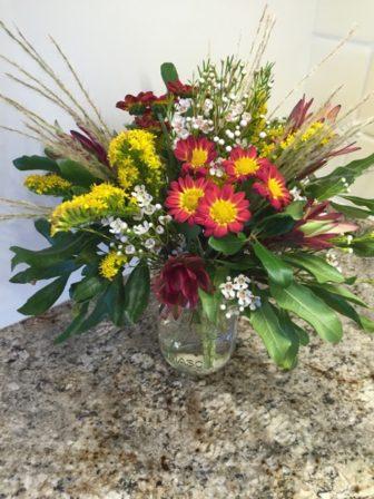 Flower arranging photo from the Darien Community Association
