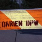Darien Department of Public Works sign on barrier saw horse