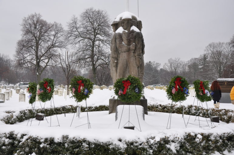 Veterans Statue wreaths snow