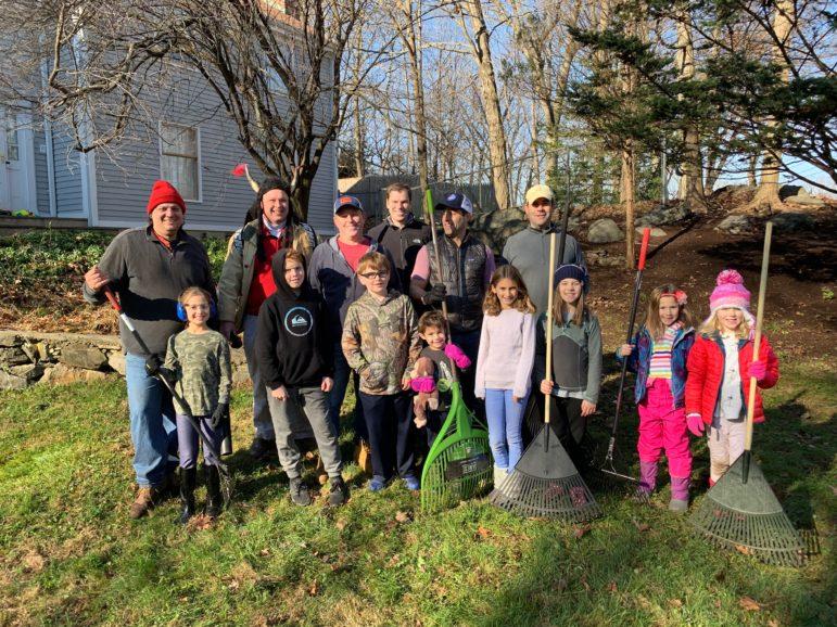 Leaf raker Volunteers At Home In Darien YMCA Adventure Guides and Princesses