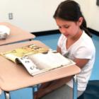 Darien Summer School student desk reading