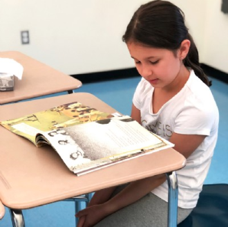 Darien Summer School student desk reading