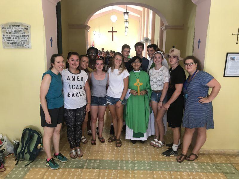 St. Luke's Parish members at the church in Cuba