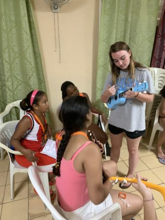 Emma Hunter teaches ukelele to campers in Cuba