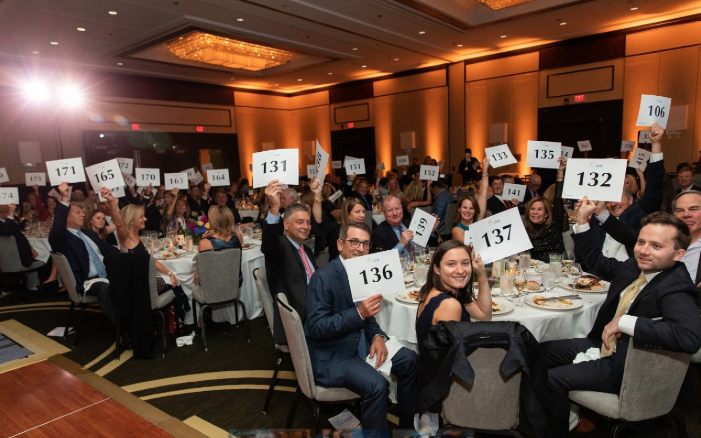 Paddles Raised Pacific House gala auction 2019