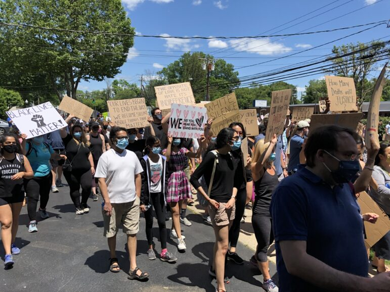 Cardboard signs protest march June 7 2020