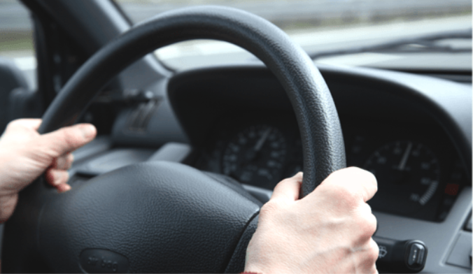 Driver hands on wheel AAA driving