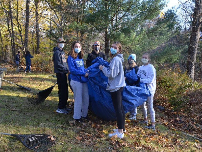 At Home In Darien leaf raking volunteers